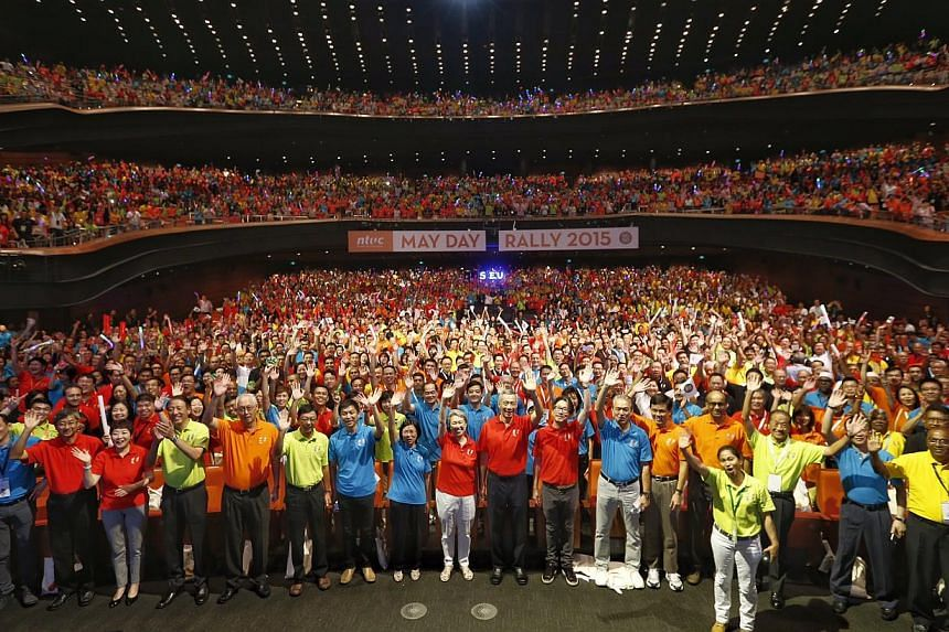 Prime Minister Lee Hsien Loong and his wife Ho Ching join some 4,000 unionists, employers and government officialsat the National Trades Union Congress (NTUC) May Day Rally on May 1, 2015.-- PHOTO: KEVIN LIM
