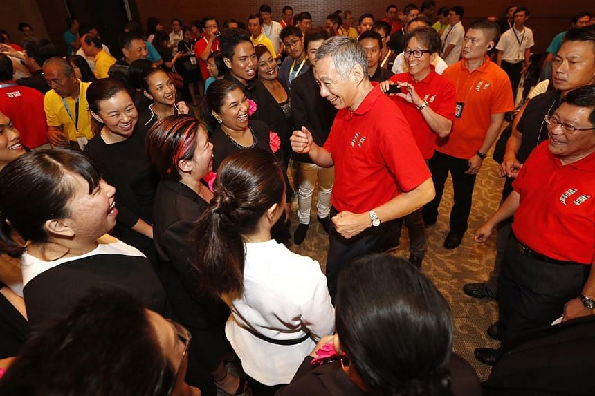 Prime Minister Lee Hsien Loong meeting performers after the May Day celebration at the May Day Rally on May 1, 2015. -- PHOTO: KEVIN LIM
