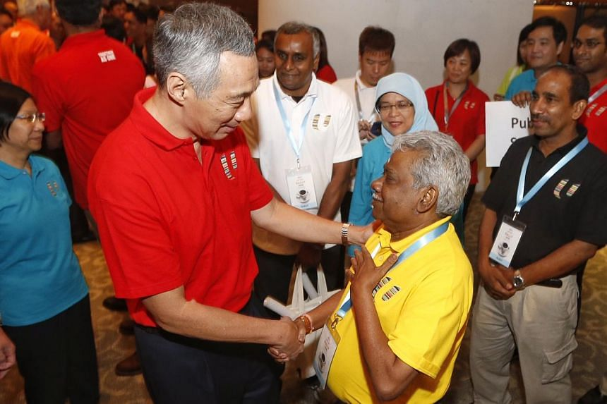 Prime Minister Lee Hsien Loong meeting trade unionist G Muthukumarasamy (second, right) after the May Day celebration. Recalling the euologies shared by unionists and tripartite partners at the labour movement's tribute event for Mr Lee, PM Lee also