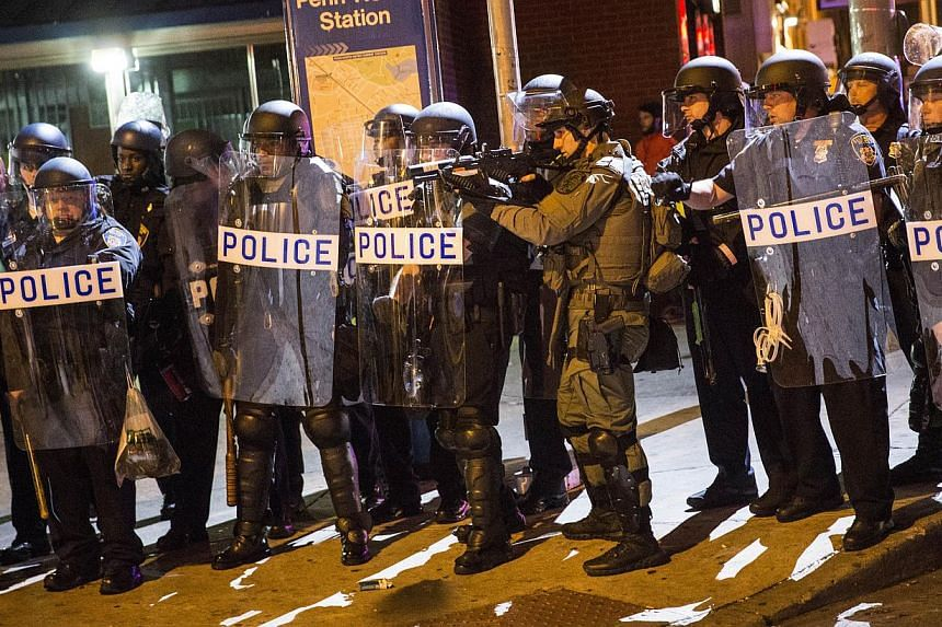 Riot police advancing on protesters and media during protests in the Sandtown neighbourhood where Freddie Gray was arrested on April 30, 2015, in Baltimore, Maryland. -- PHOTO: AFP