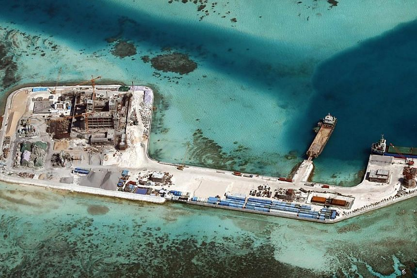 A recent handout picture from the Philippine armed forces' public affairs office shows construction by China at Chigua Reef in the disputed Spratly Islands on Feb 19. While China is justified in exercising its sovereign right, it should also be sensi