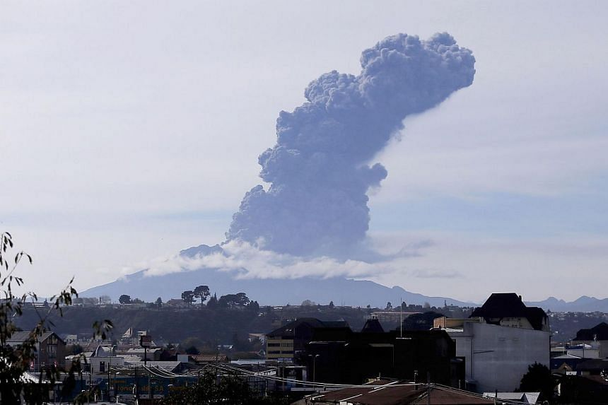 View of the Calbuco volcano from Puerto Montt, southern Chile, on April 30, 2015. The Calbuco volcano erupted again on Thursday, releasing a large column of ash into the air just over a week after it spectacularly roared to life following half a cent