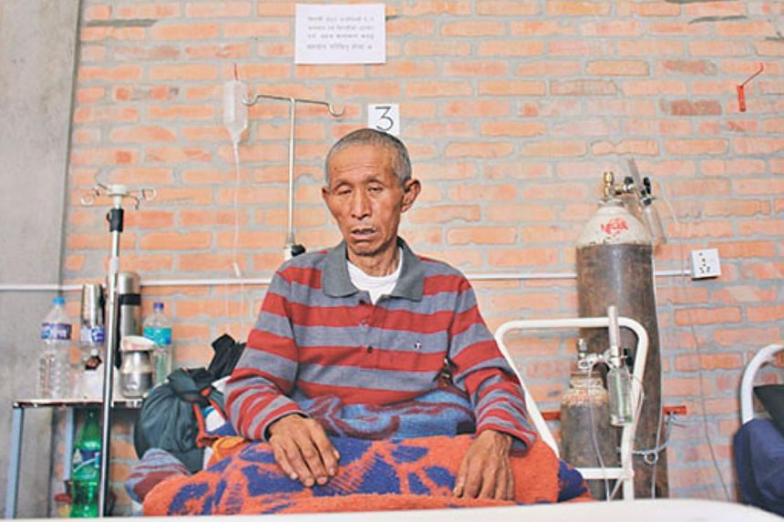 67-year-old Dal Ram Ghale of Barpak village of Gorkha, the epicentre of the earthquake, recuperating at Gorkha District Hospital. -- PHOTO: THE KATHMANDU POST/ ASIA NEWS NETWORK
