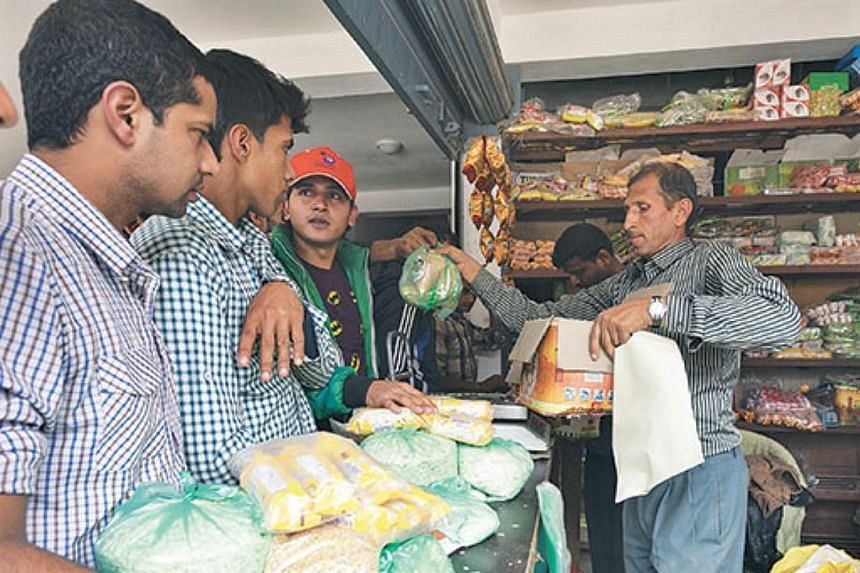 People buy daily essentials at a shop in Sindhupalchok. -- PHOTO: THE KATHMANDU POST/ ASIA NEWS NETWORK