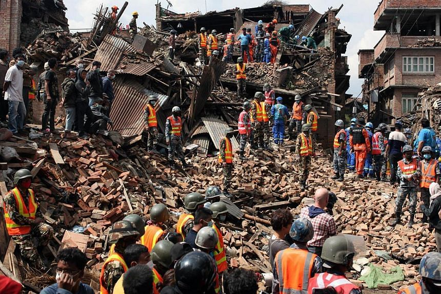 This handout photo taken on April 29, 2015, and released by the International Federation of Red Cross and Red Crescent Societies (IFRC) shows workers taking part in a rescue operation at Kolache-2 in Bhaktapur near Kathmandu, four days after the 7.8