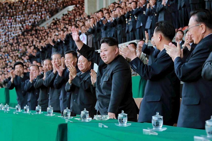 North Korean leader Kim Jong Un (centre) gestures during a men's football match in an undated photo released on April 14, 2015. North Korean diplomats on Thursday walked out of a UN conference on human rights in protest at the testimonies from three