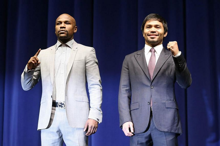 Floyd Mayweather (left) and Manny Pacquiao posing together at the start of their press conference promoting their upcoming fight on March 11, 2015, in Los Angeles, California.-- PHOTO: AFP