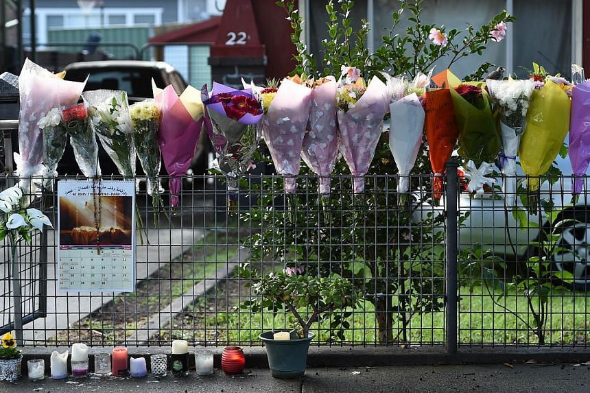 Bouquets are seen in front of the home of the parents of executed Australian drug convict Andrew Chan in Sydney on May 2, 2015. -- PHOTO: AFP