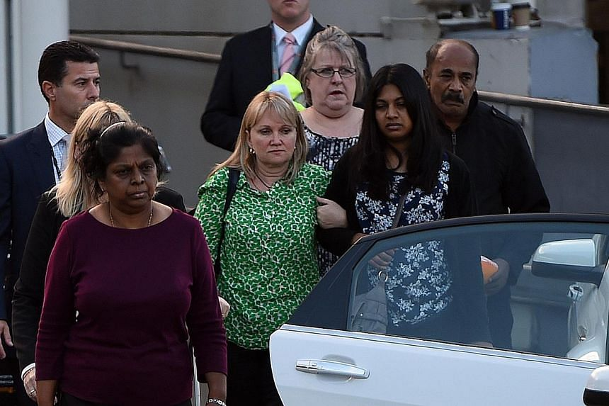Raji Sukumaran (left), Sam Sukumaran (right) and Brintha Sukumaran (second from right), the respective mother, father and sister of executed Australian drug convict Myuran Sukumaran, following the arrival of Myuran's remains at the Sydney Internation