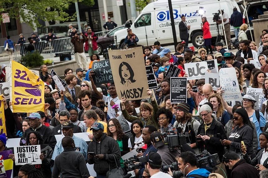 Protesters marching through the streets on May 1, 2015, in Baltimore, Maryland, despite the announcement that charges would be filed against Baltimore police officers in the death of Freddie Gray. -- PHOTO: AFP