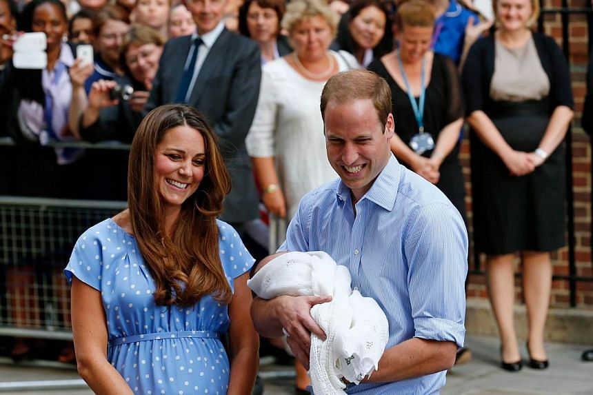Britain's Prince William and Catherine, Duchess of Cambridge show their new-born baby boy, Prince George of Cambridge, to the world's media outside the Lindo Wing of St Mary's Hospital in London on July 23, 2013. -- PHOTO: AFP
