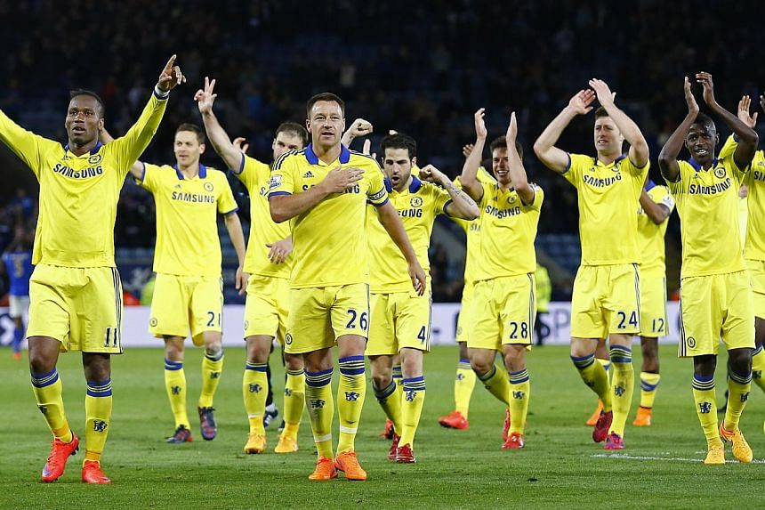 Chelsea's Didier Drogba and John Terry celebrate with team mates at the end of a match against Leicester City, on April 29, 2015. -- PHOTO: REUTERS