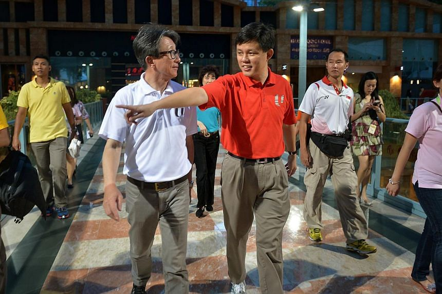NTUC president Diana Chia, secretary-general Lim Swee Say and deputy secretary-general Chan Chun Sing joining union members at the Universal Studios Singapore on May 2, 2015. -- ST PHOTO: KHUA CHEE SIONG