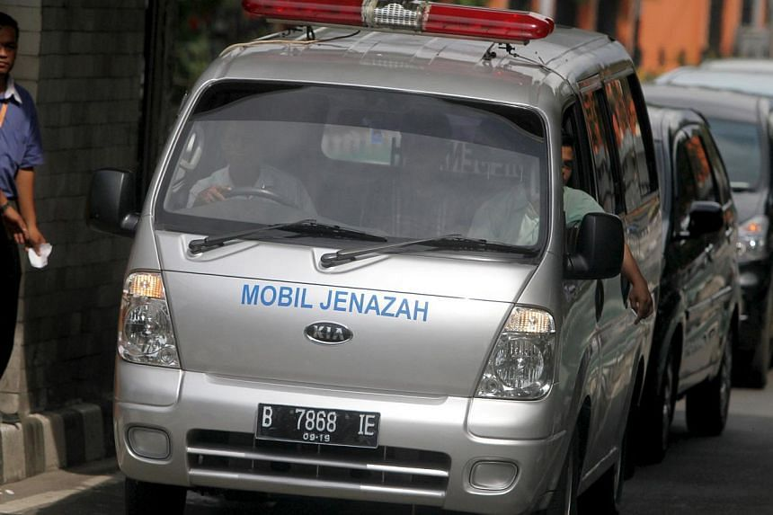An ambulance carrying one of the bodies of Australian death row prisoners Andrew Chan and Myuran Sukumaran leaving a funeral home for the Jakarta airport on May 1, 2015. -- PHOTO: REUTERS