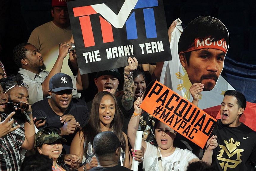 """Fans showing their support for boxers Manny Pacquiao and Floyd Mayweather at their weigh-in on May 1, 2015, in Las Vegas, one day before their """"Fight of the Century"""" on May 2 at the MGM Grand Garden Arena. -- PHOTO: AFP"""