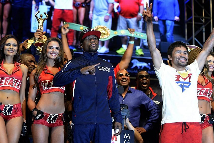 Filipino boxer Manny Pacquiao (right) and US boxer Floyd Mayweather Jr (left) posing together after their weigh-in at MGM Grand Garden Arena in Las Vegas on May 1, 2015. Pacquiao will fight Mayweather Jr. for the WBC welterweight title bout on May 2