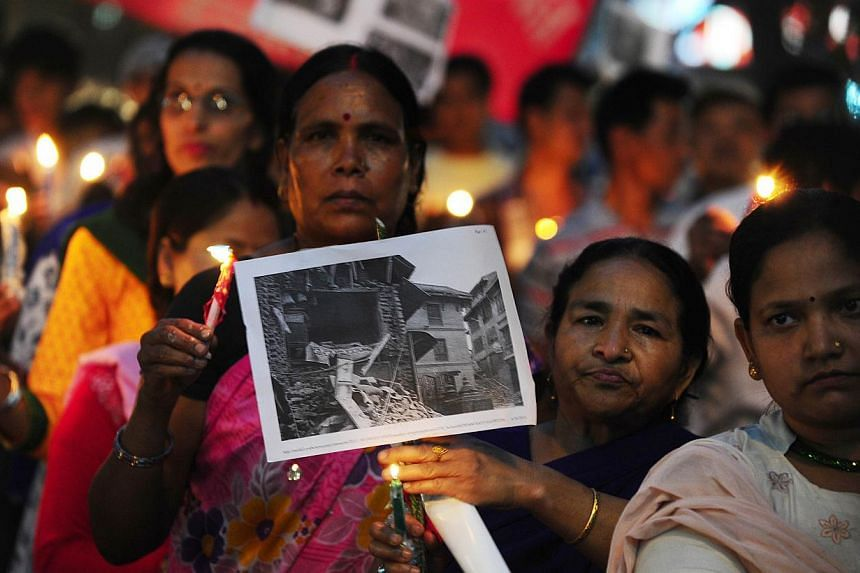 Nepalese participating in a candlelight vigil to pray for the April 25, 2015, earthquake victims, in Allahabad on May 1, 2015. -- PHOTO: AFP