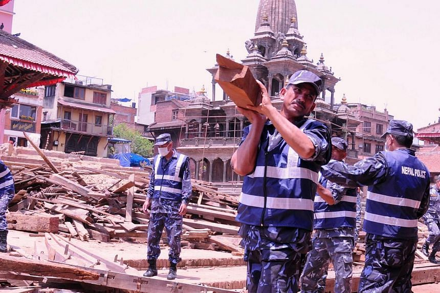 Police cleaning up medieval Patan Durbar Square. -- ST PHOTO: NIRMAL GHOSH