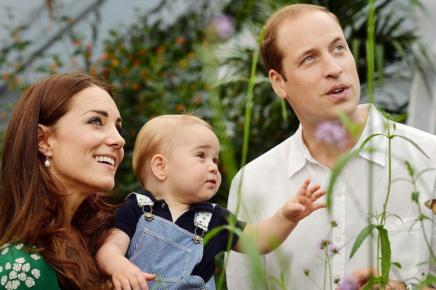 Prince William (right) and Catherine, Duchess of Cambridge (left), with their son Prince George (centre), during a visit to the Sensational Butterflies exhibition at the Natural History Museum, London, Britain on July 2, 2014. The imminent birth of P