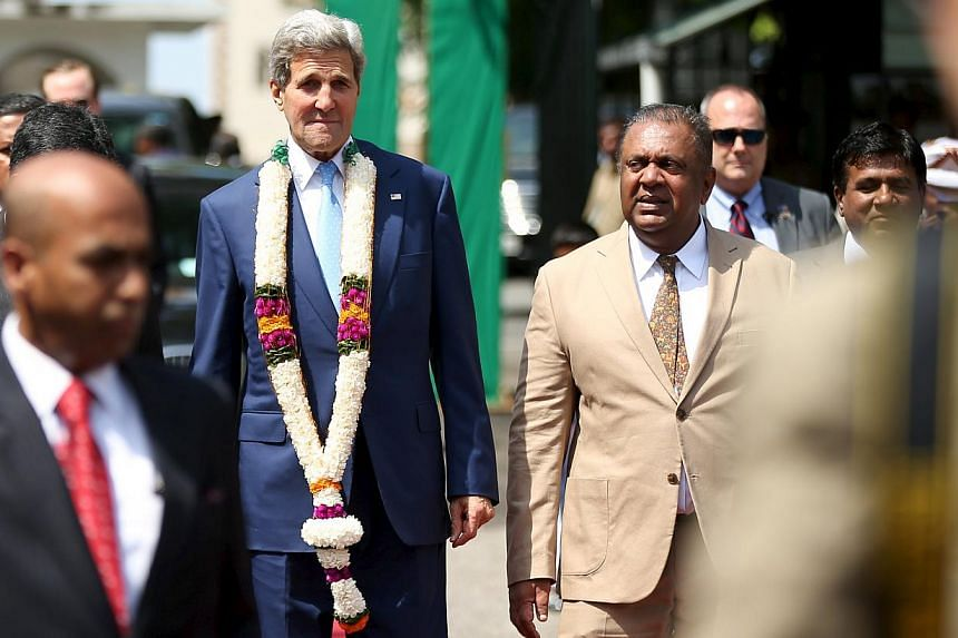 U.S. Secretary of State John Kerry arrives for a meeting with Sri Lankan Foreign Minister Mangala Samaraweera (center right) at the Ministry of Foreign Affairs in Colombo, Sri Lanka, May 2, 2015. -- PHOTO: REUTERS
