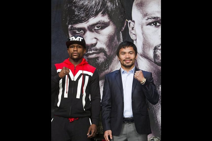 Floyd Mayweather (left) and Manny Pacquiao will face each other in the Welterweight Championship of the World boxing match. -- PHOTO: REUTERS