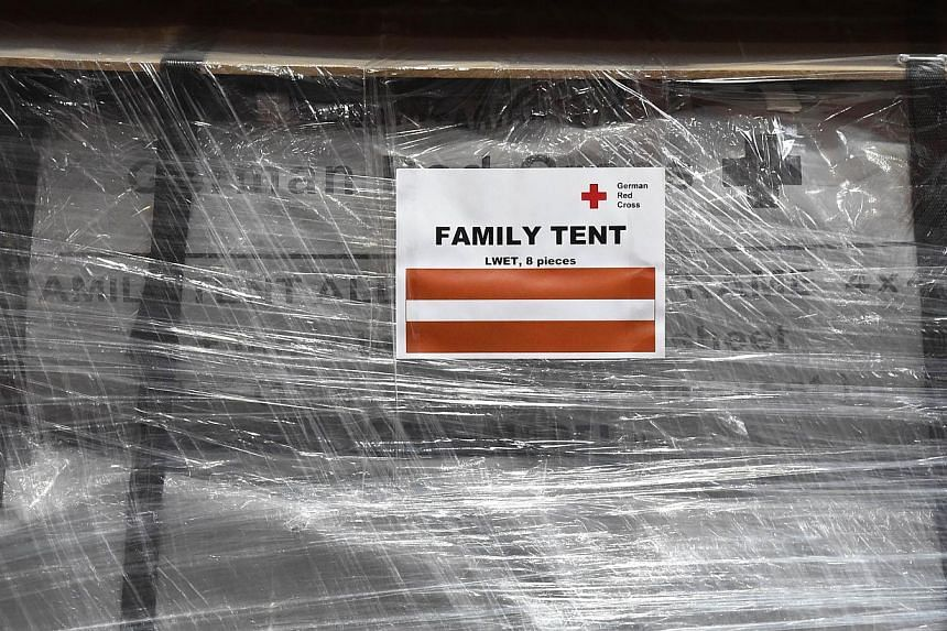 A wrapped family tent is seen at the logistics centre of the German Red Cross (DRK) at the Schoenefeld airport near Berlin, on April 27, 2015. Some of the relief goods were held up at Nepal's only international airport because of customs bottlenecks,