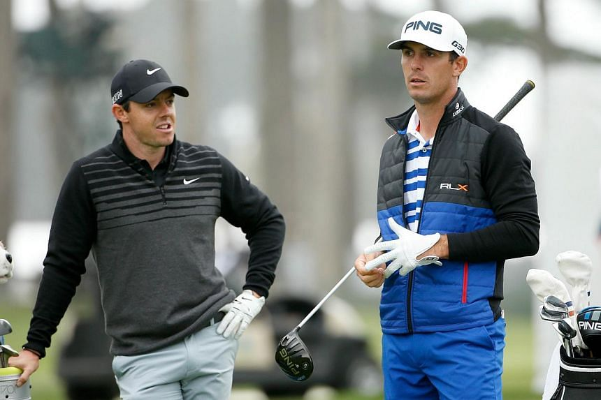 Rory McIlroy (left) of Northern Ireland talks to Billy Horschel (right) of the USA while they wait to tee off on the 16th hole during round three of the World Golf Championships Cadillac Match Play at TPC Harding Park in San Francisco, California on