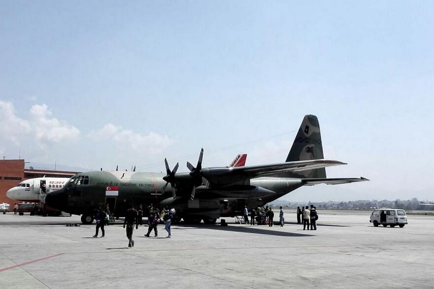 A Republic of Singapore Air Force C-130 plane carrying medical staff and supplies landed at Kathmandu airport on Saturday, May 2, 2015. -- ST PHOTO: LIM YAN LIANG