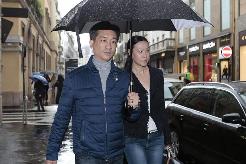 Thai businessman Bee Taechaubol walks with his wife in Milan, Italy, on April 27, 2015. Beewill on Saturday purchase a controlling 51 per cent stake in ailing Serie A giants AC Milan from club owner Silvio Berlusconi, Italian media report.&nbsp