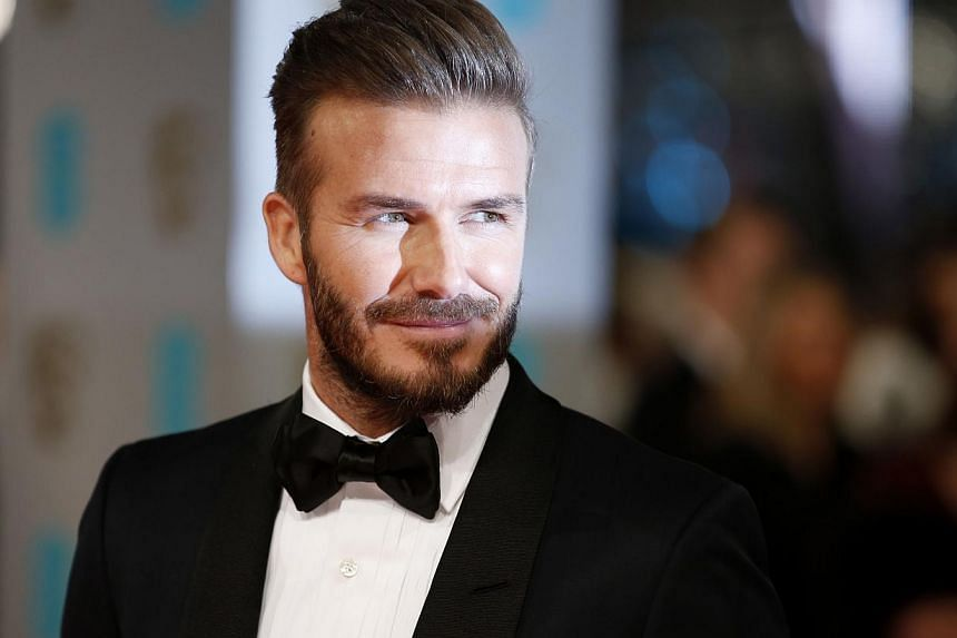 David Beckham (above, in February) will celebrate his 40th birthday on Saturday with a star-studded bash in Morocco as the Manchester United and England legend shows retirement has done little to diminish his love of the limelight. -- PHOTO: AFP