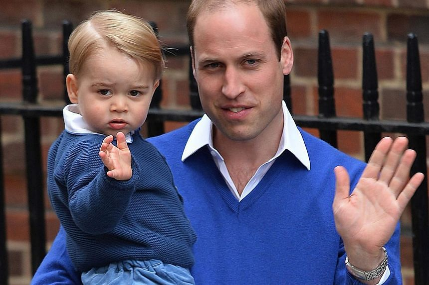 Britain's Prince William arrives with son Prince George at the Lindo Wing of St Mary's Hospital in Paddington, west London, to visit his wife and newborn daughter on May 2, 2015. -- PHOTO: EPA