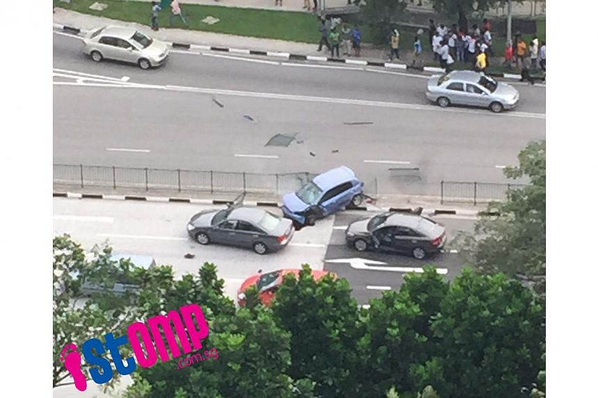 A three-car accident at Boon Lay Way on Friday was caused by a suspected drug trafficker who was trying to evade arrest. -- PHOTO: STOMP