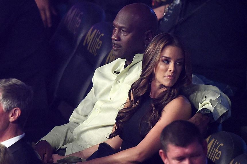 Michael Jordan and wife Yvette Prieto watches the Leo Santa Cruz against Jose Cayetano featherweight bout at MGM Grand Garden Arena in Las Vegas, Nevada, on May 2, 2015. -- PHOTO: AFP
