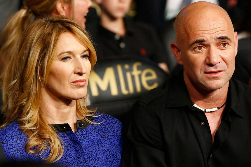 Andre Agassi and wife Steffi Graf watches the Leo Santa Cruz against Jose Cayetano featherweight bout at MGM Grand Garden Arena in Las Vegas, Nevada, on May 2, 2015. -- PHOTO: AFP