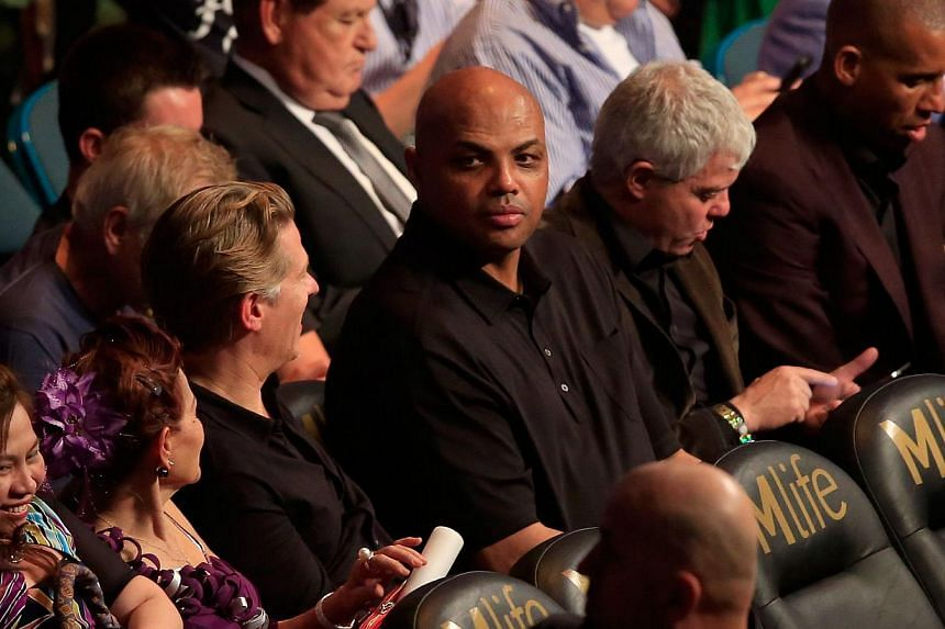 Charles Barkley watches the Leo Santa Cruz against Jose Cayetano featherweight bout at MGM Grand Garden Arena in Las Vegas, Nevada, on May 2, 2015. -- PHOTO: AFP