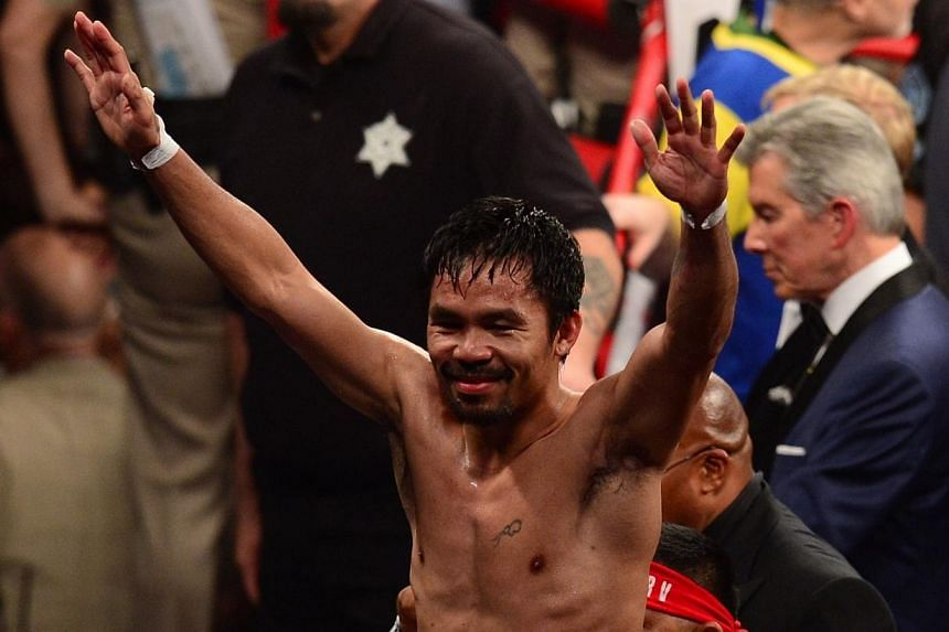 Manny Pacquiao reacts after his fight against Floyd Mayweather Jr. in a welterweight unification bout on May 2, 2015 at the MGM Grand Garden Arena in Las Vegas, Nevada. -- PHOTO: AFP