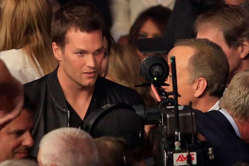 Quarterback Tom Brady attends the welterweight unification championship bout between Floyd Mayweather Jr. and Manny Pacquiao  at MGM Grand Garden Arena in Las Vegas, Nevada, on May 2, 2015. -- PHOTO: AFP