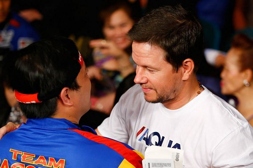 Mark Wahlberg attends the welterweight unification championship bout at MGM Grand Garden Arena in Las Vegas, Nevada, on May 2, 2015. -- PHOTO: AFP