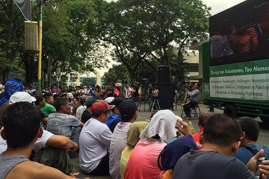 Thousands gather at a public park in Marikina, a suburb east of the capital Manila, for a free viewing of the Pacquiao-Mayweather mega fight. -- PHOTO: RAUL DANCEL