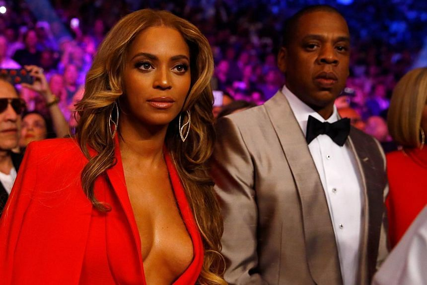Beyonce Knowles and Jay Z attend the welterweight unification championship bout at MGM Grand Garden Arena in Las Vegas, Nevada, on May 2, 2015. -- PHOTO: AFP