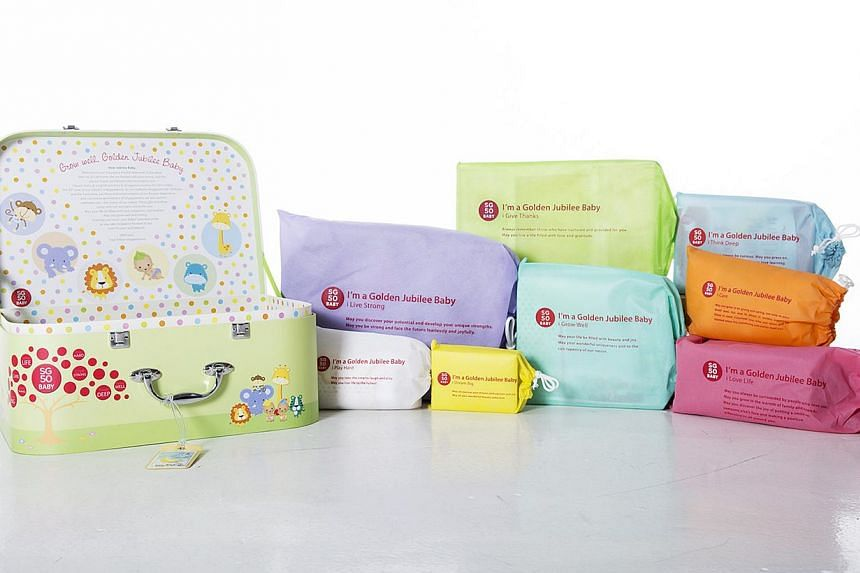 The SG50 Baby Jubilee gift set, consisting of a medallion, a shawl, a baby sling, a set of baby clothes, a diaper bag, a scrapbook, a photo frame and a set of baby books. -- PHOTO: THE NATIONAL POPULATION & TALENT DIVISION