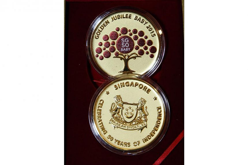 A gold-plated medallion, one of the items in the SG50 Baby Jubilee gift set. -- PHOTO: ST FILE
