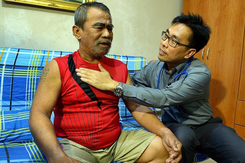 Dr Ng Wai Chong attending to Mr Osman Abdullah, 59. Caring for the elderly has been eye-opening for Dr Ng, medical director of the Tsao Foundation's Hua Mei Centre for Successful Ageing, as he not only treats patients' medical conditions but also hel