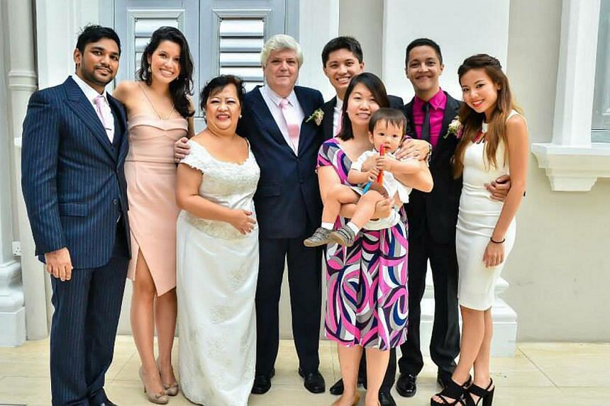 Mrs Estrellita and Mr Anthony Twohill (centre) with their family at the surprise wedding ceremony to celebrate their 30th wedding anniversary. They are with (from far left) Mr Sanjey Chandran and wife Natalya Twohill, Mr Edmund Twohill and his wife M