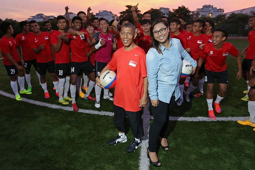 Kit man Zainol Abidin Omar, 56, and his daughter Nurul Jannah, 25, with the national Under-23 team. Mr Zainol was diagnosed with liver cancer last year but Ms Nurul donated 70 per cent of her liver to him. Now, he is back in action.