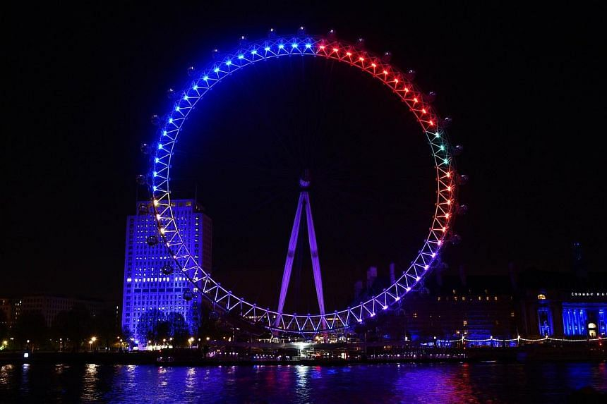 The London Eye overlooking the River Thames as seen on Friday, lit in colours that represent the different political parties vying for support in the British general election. The colours are meant to reflect how many interactions each party chalks u