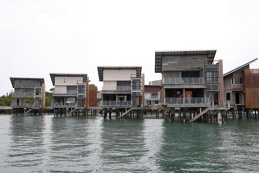 Bungalows being built over the sea off Batam that are part of a Funtasy Island Development project.