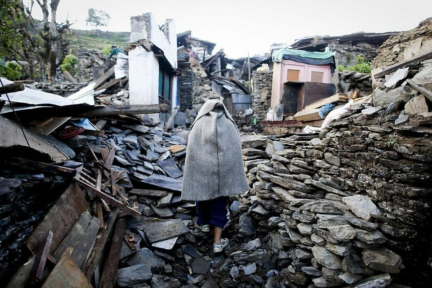 A man walks through what is left from Barpak village, Gorkha district, epicentre of the devastating earthquake that hit the country on April 25, 2015. -- PHOTO: EPA