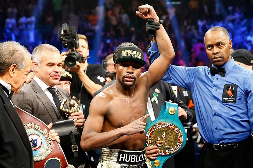 Floyd Mayweather Jr. celebrates the unanimous decision victory during the welterweight unification championship bout on May 2, 2015 at MGM Grand Garden Arena in Las Vegas, Nevada. -- PHOTO: AFP