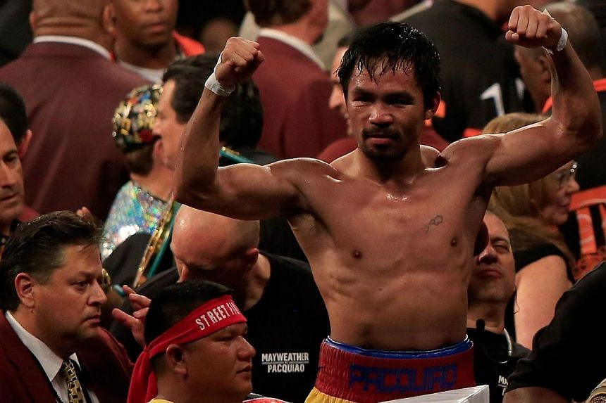 Manny Pacquiao in the ring after losing to Floyd Mayweather Jr. at the welterweight unification championship bout on May 2, 2015  at the MGM Grand Garden Arena in Las Vegas, Nevada. -- PHOTO: AFP